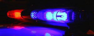 Police Car Lights representing felony or misdemeanor criminal charges - Criminal Defense Attorney Christopher A. Spedding, Lexington Kentucky